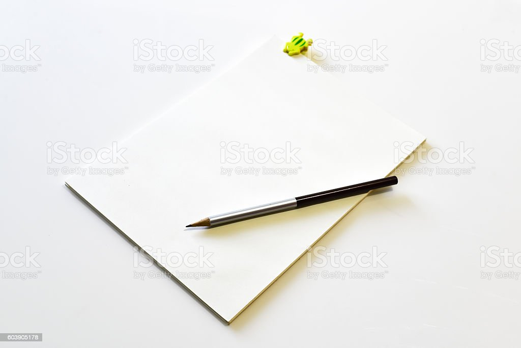 blank notebook with yellow clipboard pencil Thailand stock photo