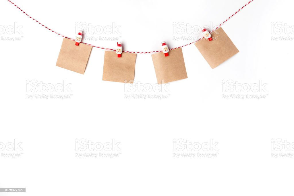 Blank notes craft on clothespins, Top view White Background Christmas New Year stock photo