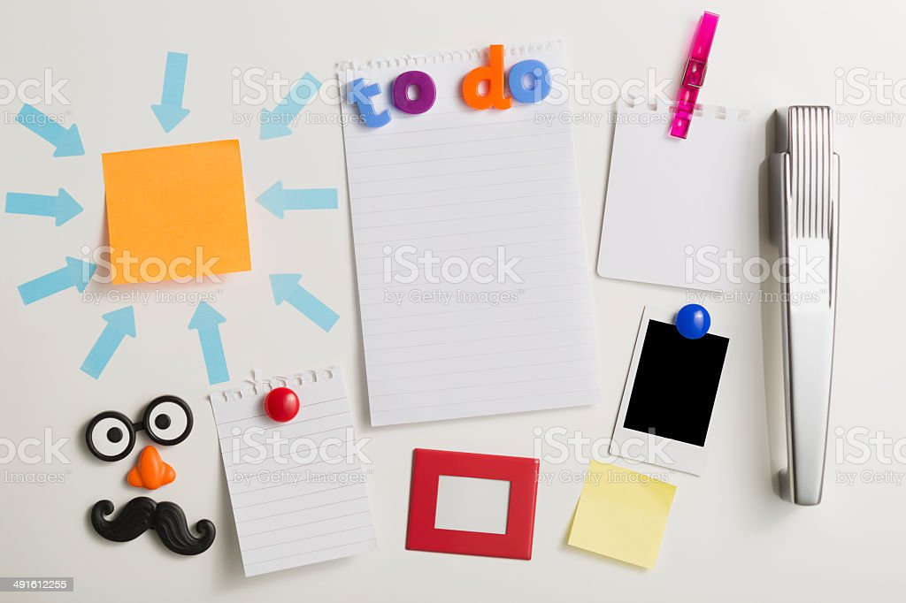 Blank notes picture frames and prints on refrigerator door stock photo