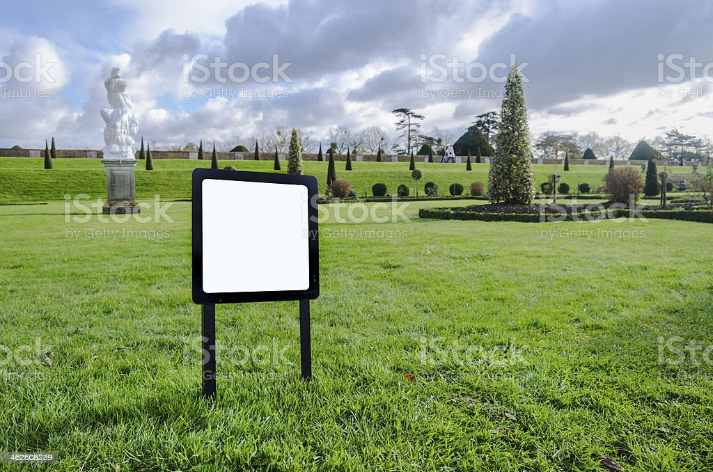 Blank notice Board on the lawn garden stock photo