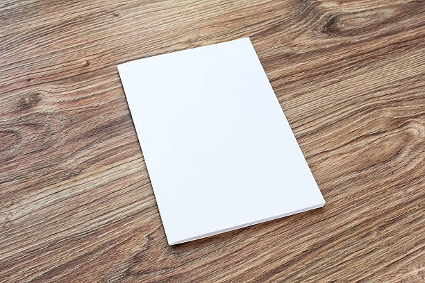 Blank of brochure is on a wooden desk. Blank of brochure is on a wooden desk. Template for your design.  catalog stock pictures, royalty-free photos & images