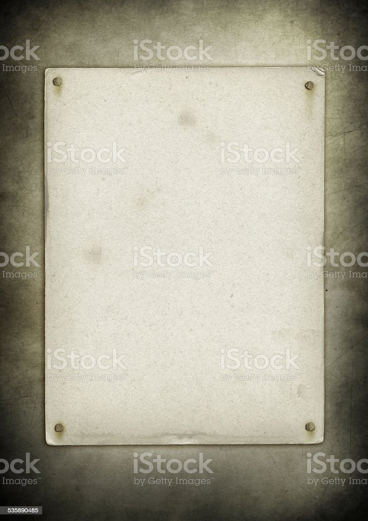 Blank old poster nailed on a grunge wall stock photo