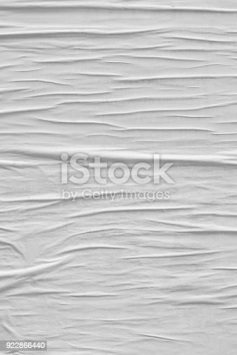 962578882 istock photo Blank old ripped torn crumpled creased posters grunge textures backdrop backgrounds 922866440