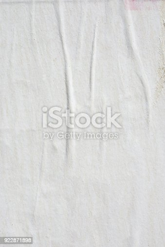 962578882 istock photo Blank old ripped torn crumpled creased posters grunge textures backdrop backgrounds 922871898