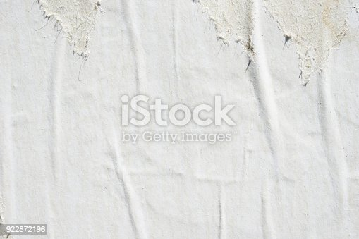 962578882 istock photo Blank old ripped torn crumpled creased posters grunge textures backdrop backgrounds 922872196