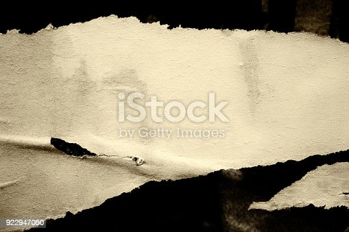 962578882 istock photo Blank old ripped torn crumpled creased posters grunge textures backdrop backgrounds 922947050