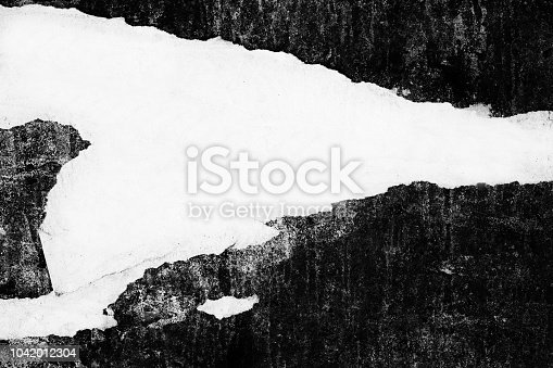 istock Blank old ripped torn paper crumpled creased posters grunge textures backdrop backgrounds 1042012304