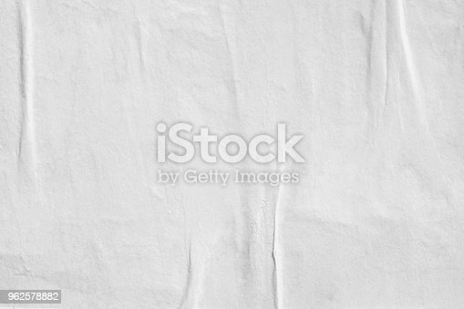 istock Blank old ripped torn paper crumpled creased posters grunge textures backdrop backgrounds 962578882