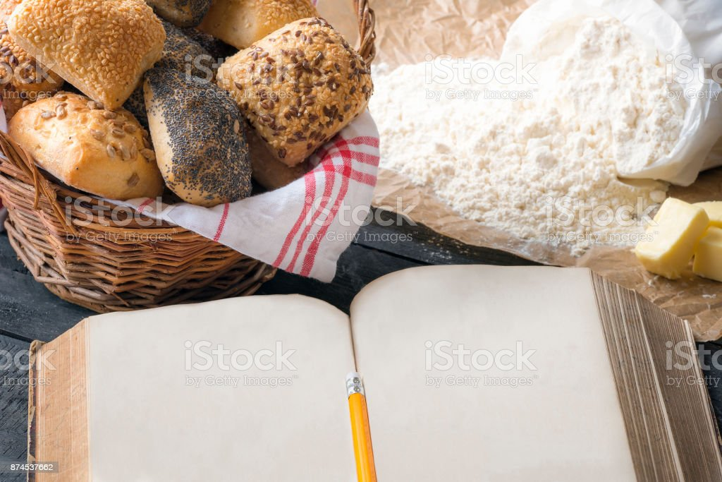 Blank open book and bread buns stock photo