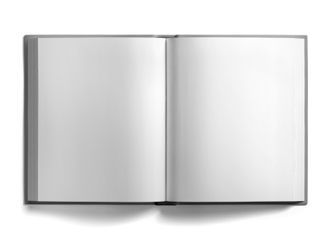 Open book with blank pages on white surface with soft shadow