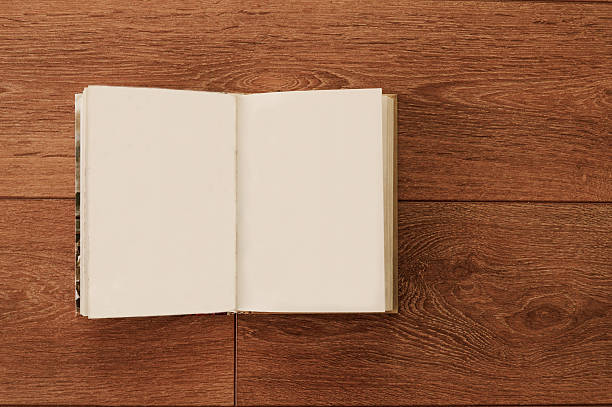 Blank open notebook on a wooden surface stock photo