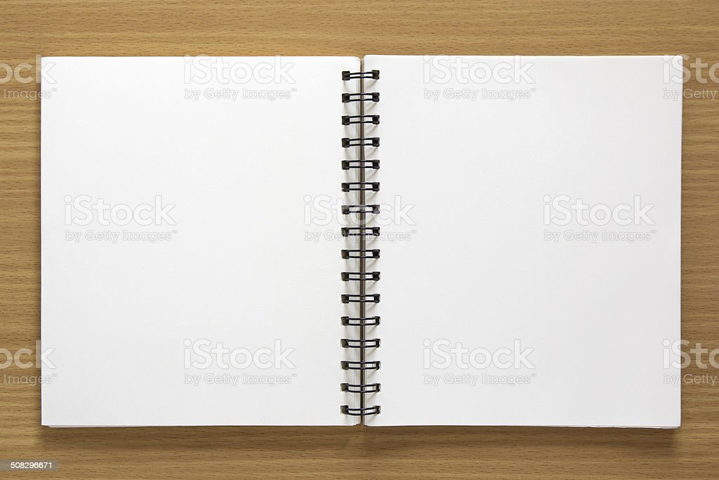 blank open spiral notepad stock photo