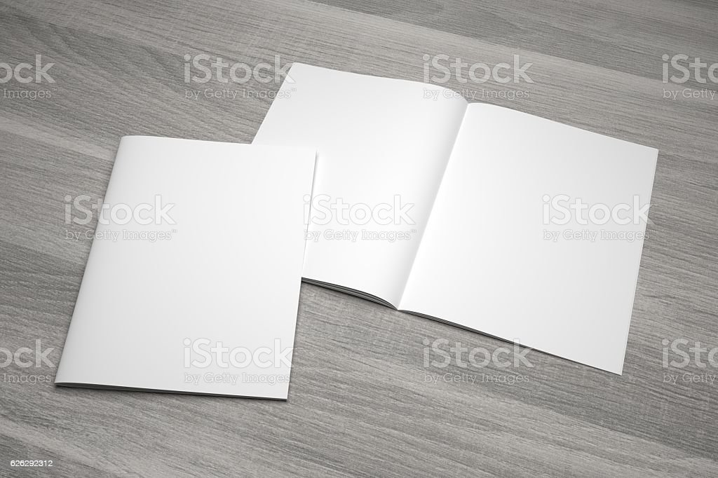 Blank opened 3D illustration magazine mockup with cover on wood. stock photo