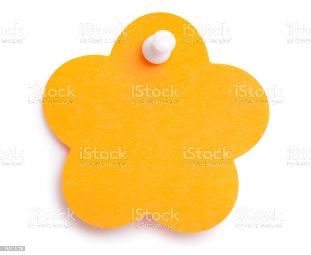 Blank Orange flower-shape sticky note with tack royalty-free stock photo