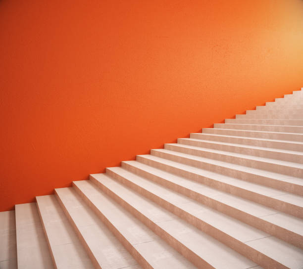 blank orange wall and stairs - staircase stock photos and pictures