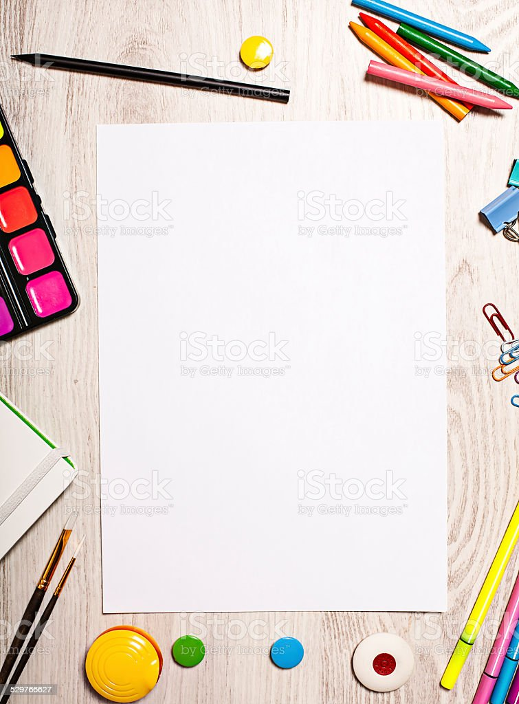 Blank page mockup on table with office tools stock photo