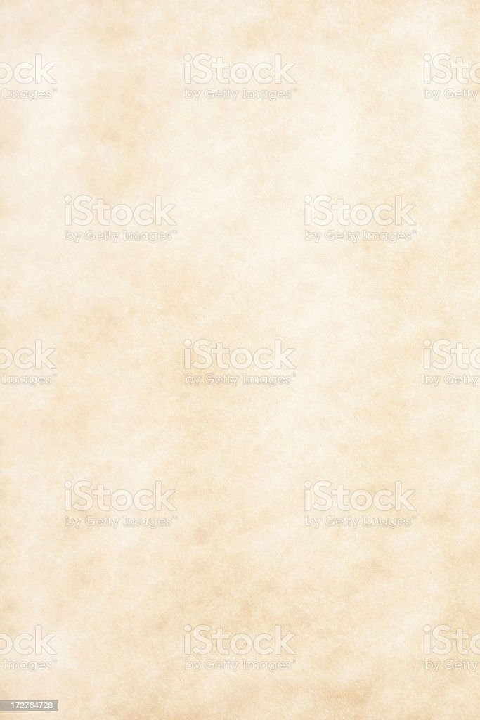 A blank page of aged paper in tan royalty-free stock photo
