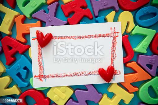 849182490 istock photo Blank Painting paper on multi colored alphabets background 1196665275