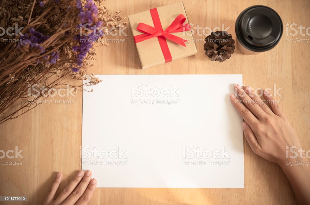 blank paper A4 flyer for mockup template design logo branding on wooden background. stock photo