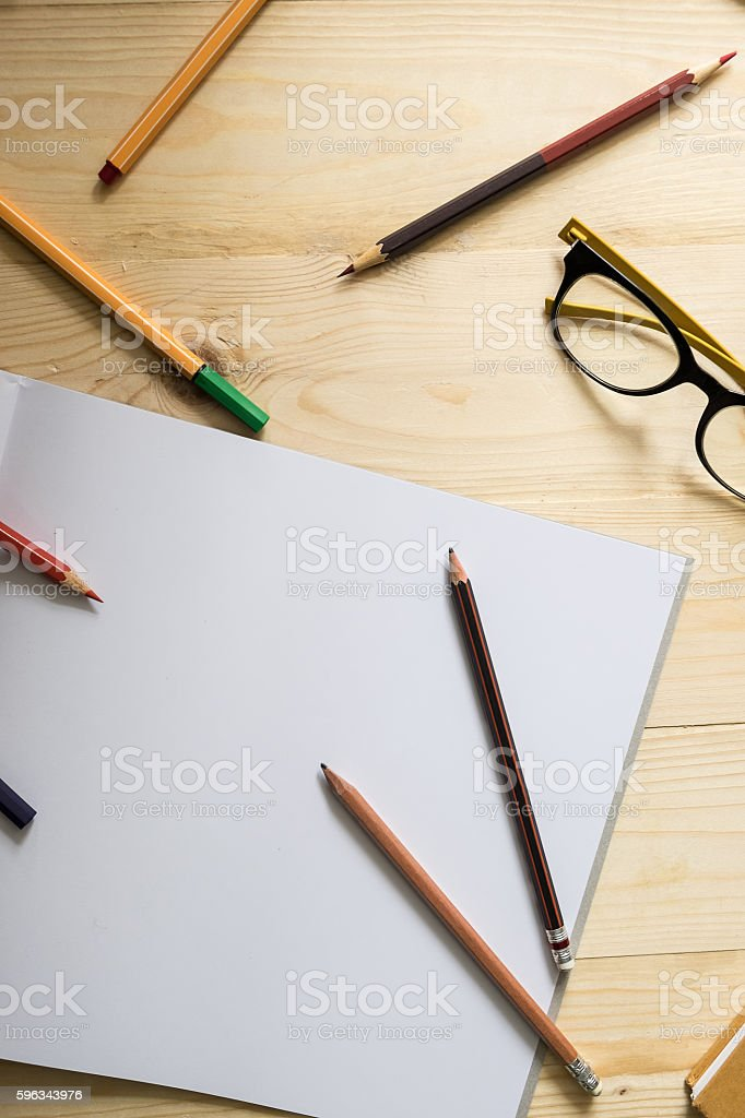 blank paper and colorful pencils and glasses royalty-free stock photo
