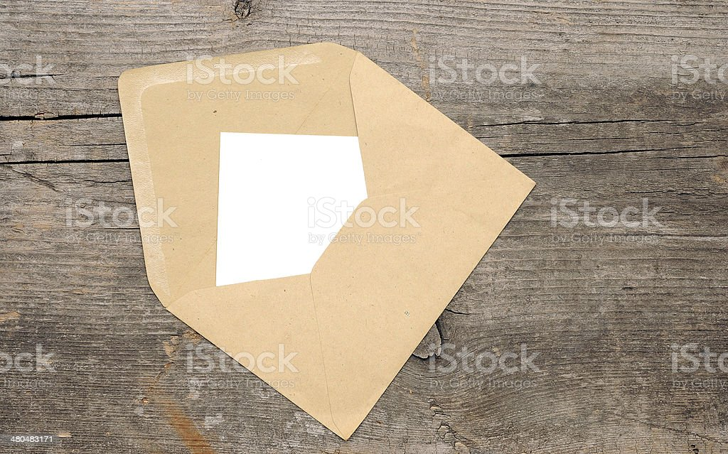 Blank paper and envelope on old wooden background stock photo