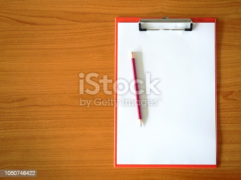 914465180 istock photo Blank paper and pencil  on clipboard. 1050746422