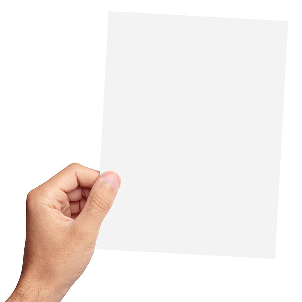 Blank paper in hand stock photo