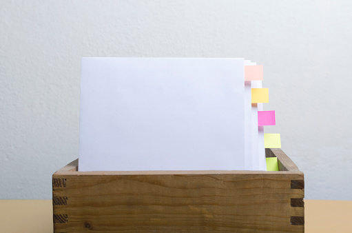 668340340 istock photo Blank paper in the box folder, bookmarks against white background.Concept of business documintation 1192061813