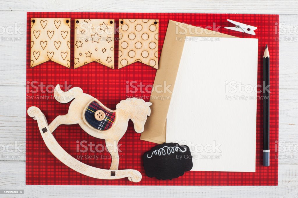 Blank paper note, craft envelope on red checkered background
