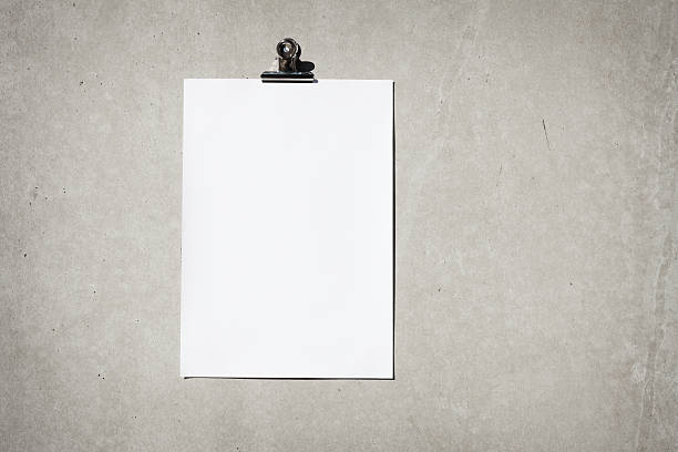 Blank paper on concrete wall stock photo