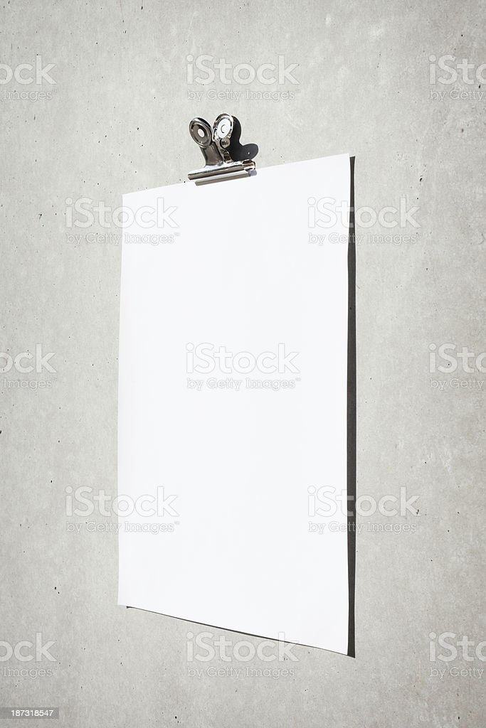 Blank paper on concrete wall royalty-free stock photo