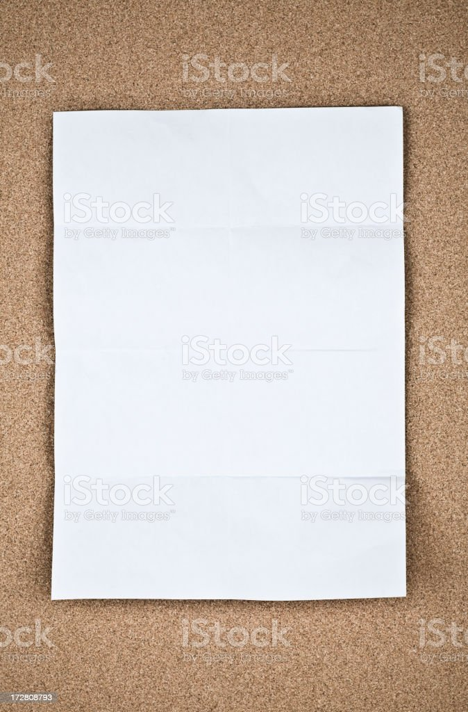 Blank paper on cork royalty-free stock photo