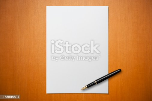 Blank paper on Desk with a pen.