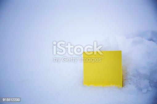 istock blank paper on the snow background 915512200