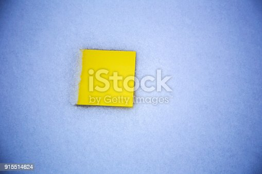 istock blank paper on the snow background 915514624