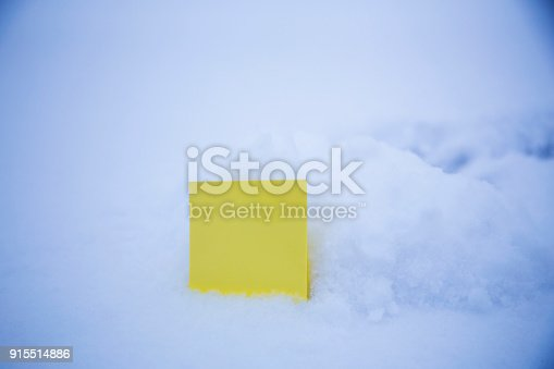 istock blank paper on the snow background 915514886