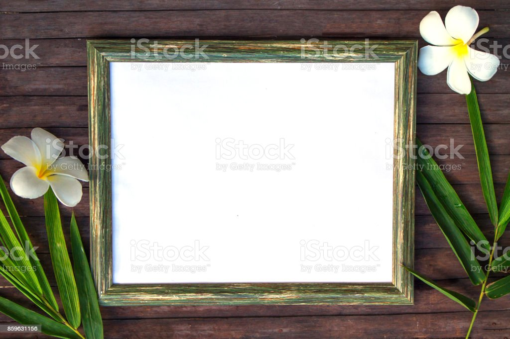 Blank paper on wooden background flat lay. Natural rustic photo frame with blank place for text. stock photo