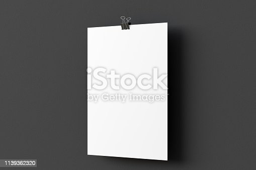 931839050 istock photo Blank paper poster hanging on binder clip 1139362320