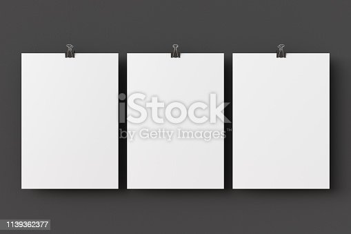 931839050 istock photo Blank paper poster hanging on binder clip 1139362377