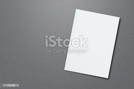 932100364 istock photo Blank paper sheets for brochure on grey background, top view. Mock up 1219558814