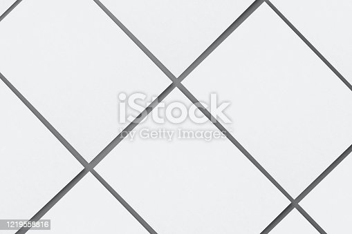 932100364 istock photo Blank paper sheets for brochure on grey background, top view. Mock up 1219558816
