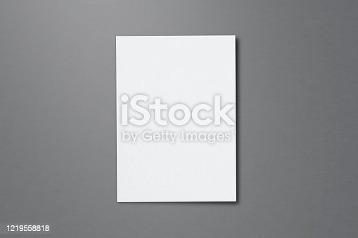 932100364 istock photo Blank paper sheets for brochure on grey background, top view. Mock up 1219558818
