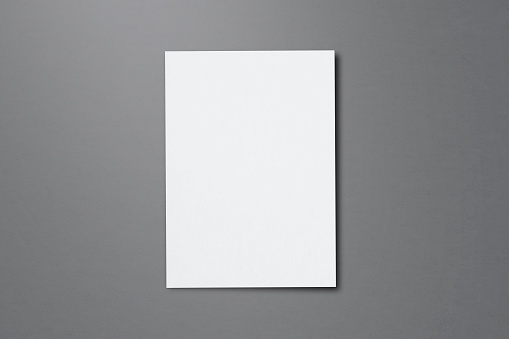 Blank paper sheets for brochure on grey background, top view. Mock up