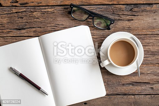 istock Blank paper with pen and cup of coffee 629729224