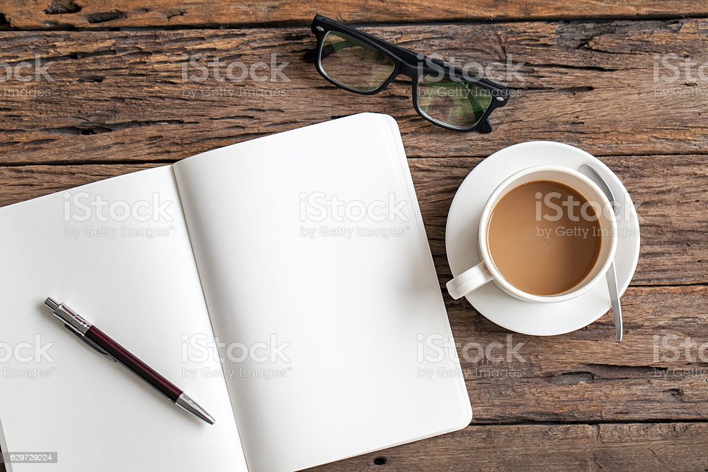 Blank paper with pen and cup of coffee stock photo