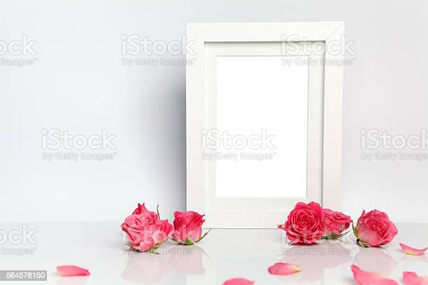 Blank photo frame and pink roses on white table background picture id564578150?b=1&k=6&m=564578150&s=612x612&h=qvcqaildkhxavppsfc0kej4qcge5bsdaza9kek5 kho=
