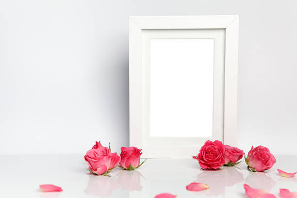Blank photo frame and pink roses on white table background picture id564578150?b=1&k=6&m=564578150&s=612x612&w=0&h=i1mwx1f6j3gngyjfon6zh0mpvhswaohbmb5t2cgd 5s=
