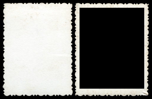 Blank photo frame & background isolated on black.