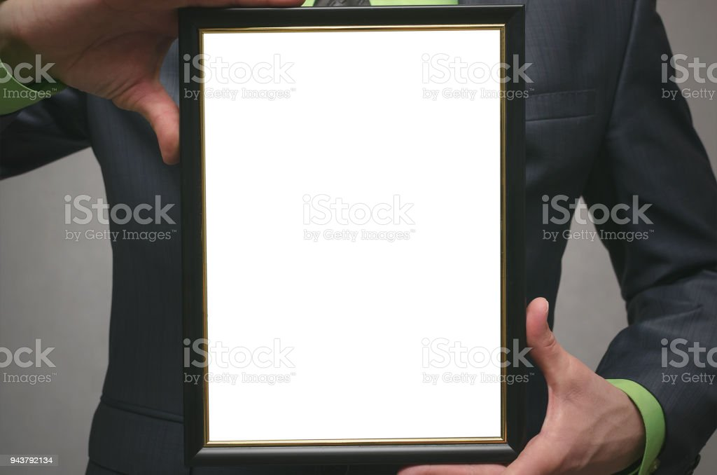 Blank photo frame with copy space for picture or for text in businessman hands. stock photo