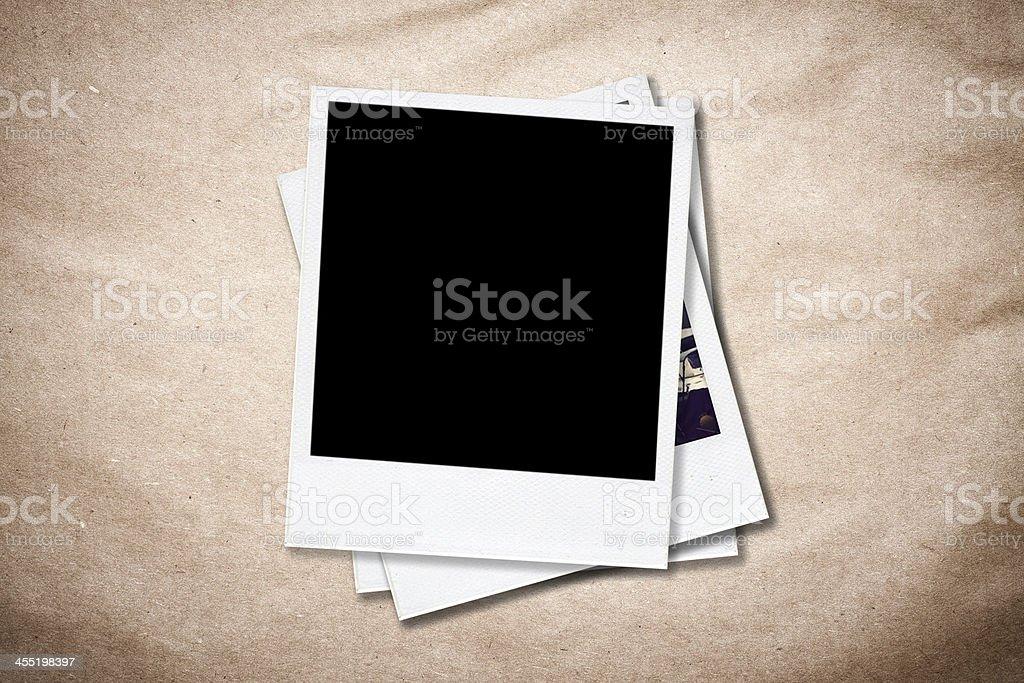 Blank photo frames on old paper background. stock photo